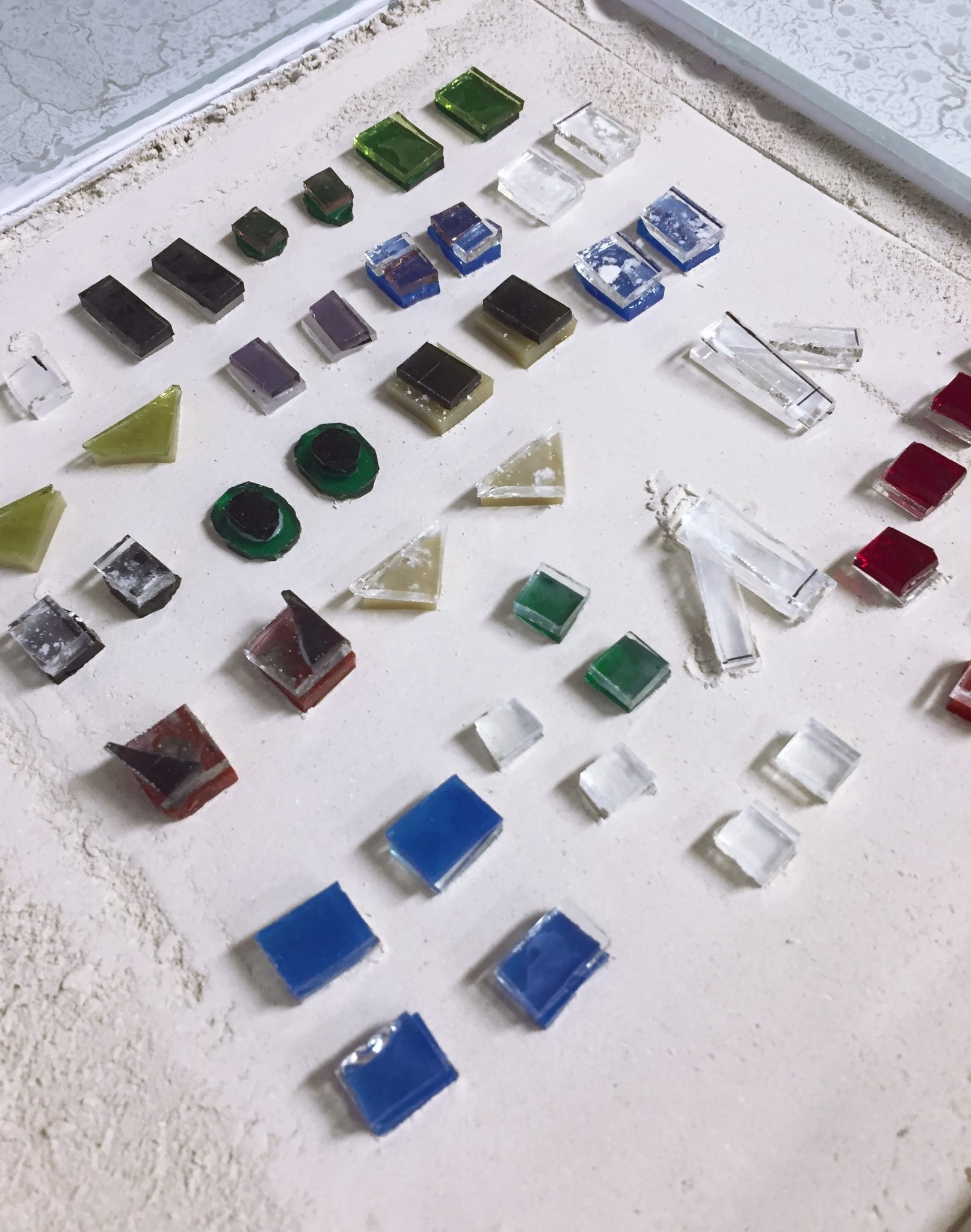 Jewelry pieces before the kiln
