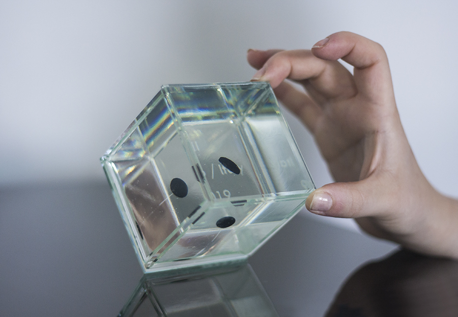 Awards and Trophies from Glass. Small transparent glass cube with black dot floating inside. Glass Point