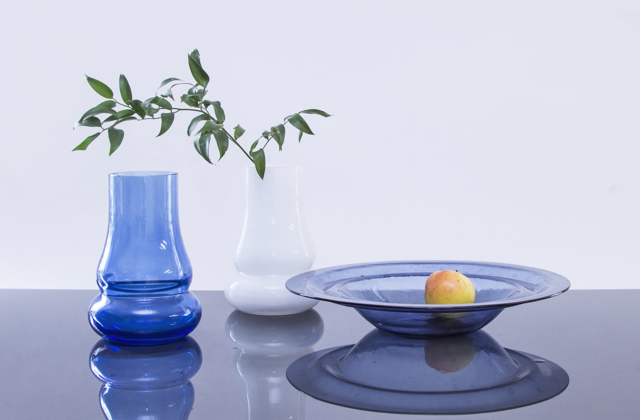 """Elegant and minimalistic handmade glass fruit plate and vase. Design collection """"Motion"""". Hand blown glass. Glass Point"""