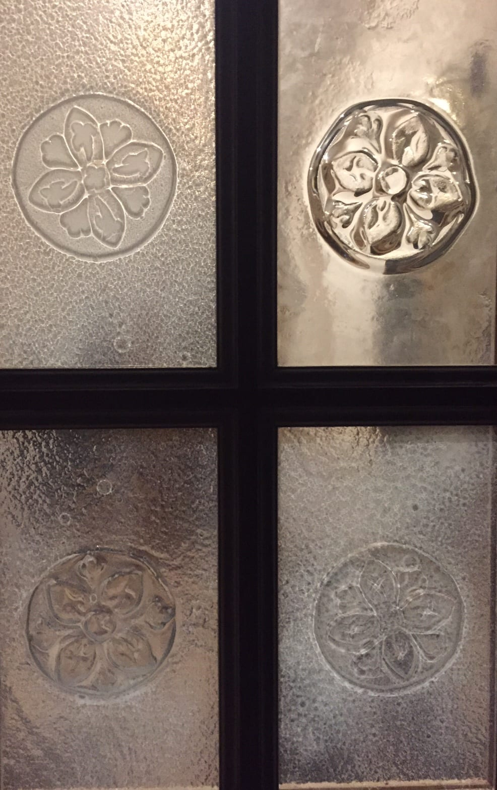 Glass in Interior Design. Glass panel door with custom flower relief. Glass Point