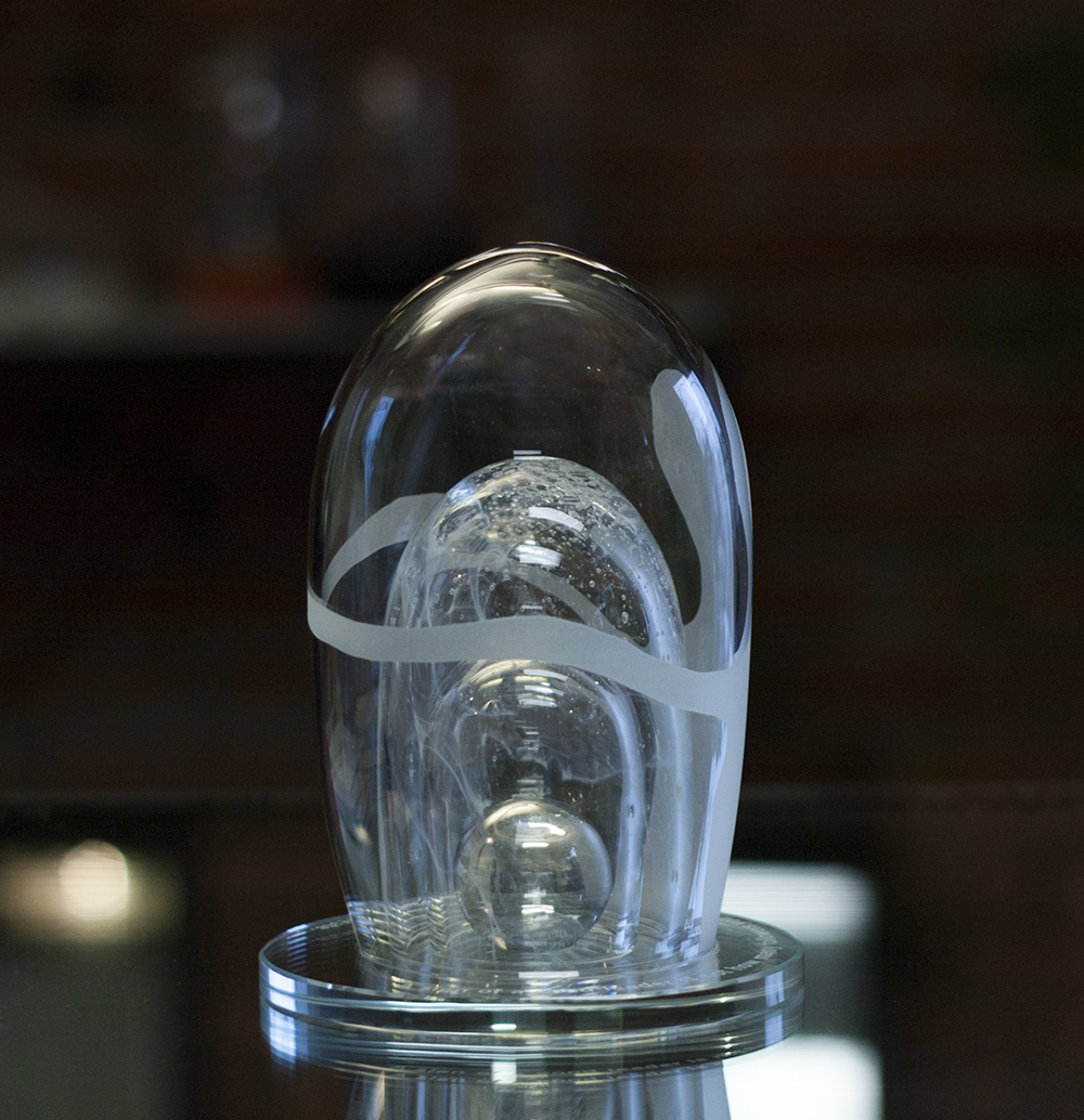 Awards and Trophies from Glass. Unique custom glass award with ball inside. Glass Point