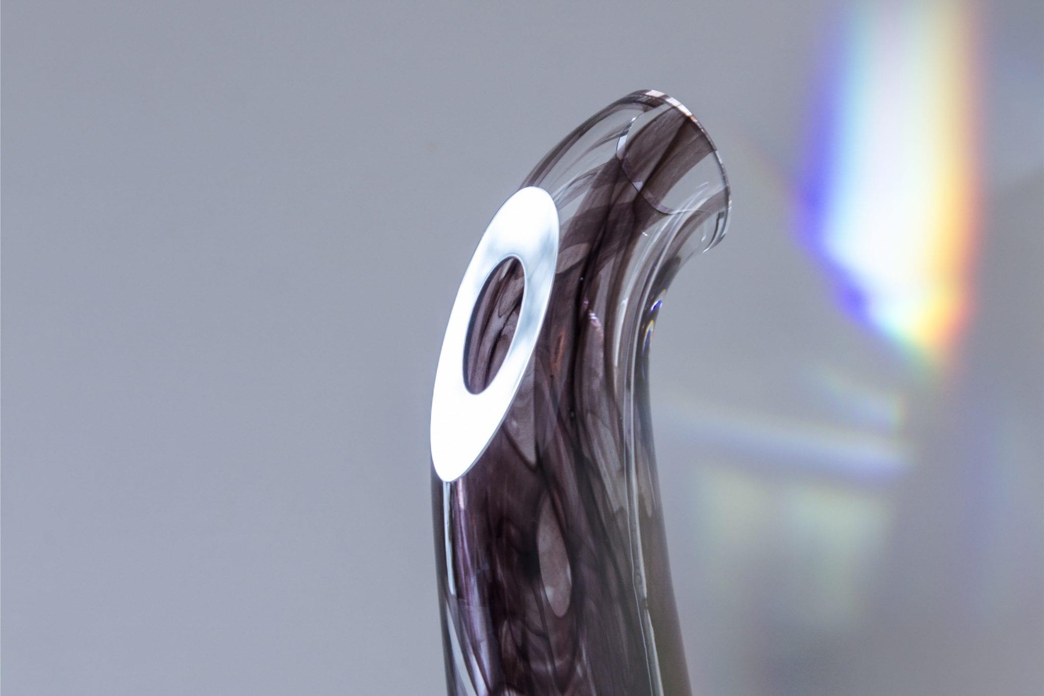 Custom handmade Glass Items. Unique glass vase closeup. Glass Point